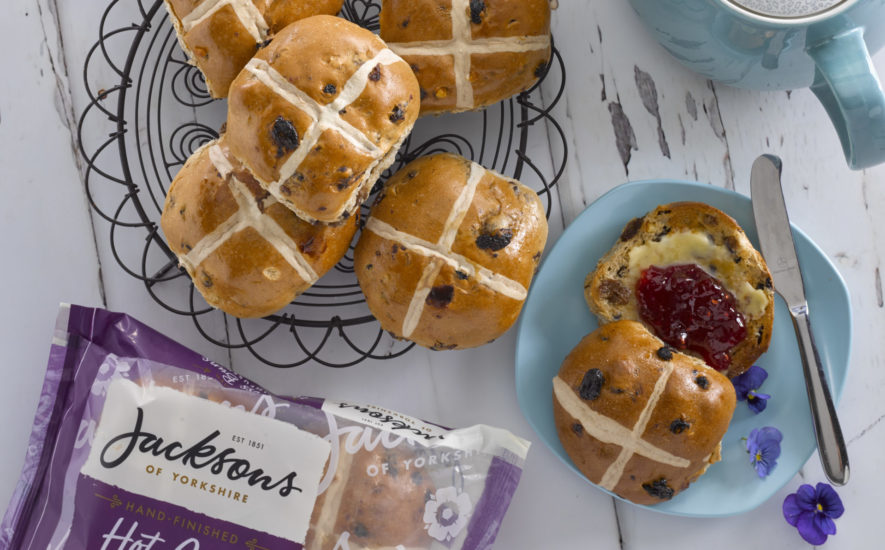 NEW   tea-infused,   hand-finished   Hot   Cross   Buns